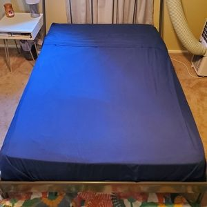 Full navy blue polyester flat and fitted sheet
